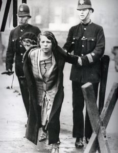 Suffragette arrested by police